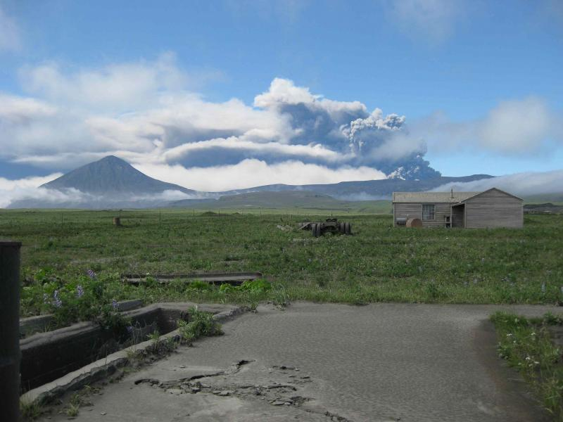 View of the Okmoks eruption plume as seen from Fort Glenn (ranch building in foreground) on 8-03-2008